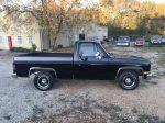 1986 Chevrolet C10 pickup black side view