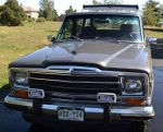 1989 Jeep Grand Wagoneer with roof rack and Hella lights